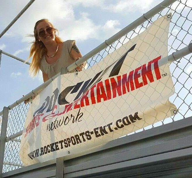 RSEN intern ritual: Rachel Lee hanging the banners pre-game at Largo (RSEN photo)