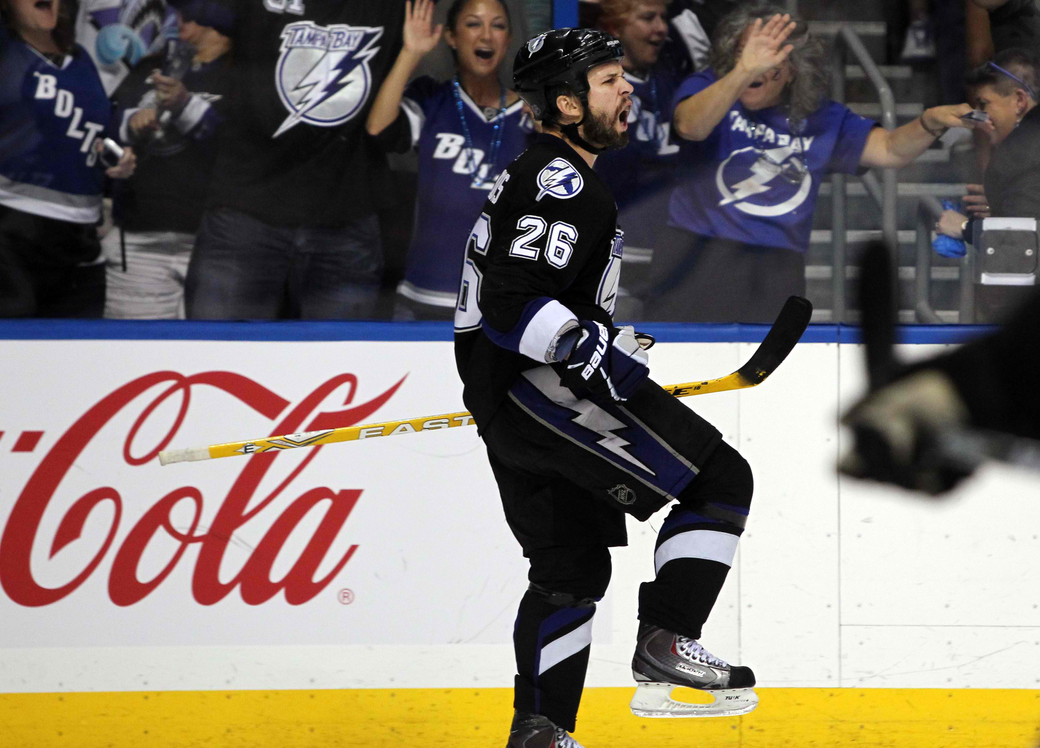 Marty St. Louis celebrates his empty net goal that got the fat lady up and the bus started for the Bruins. (photo by Kim Klement/US Presswire)