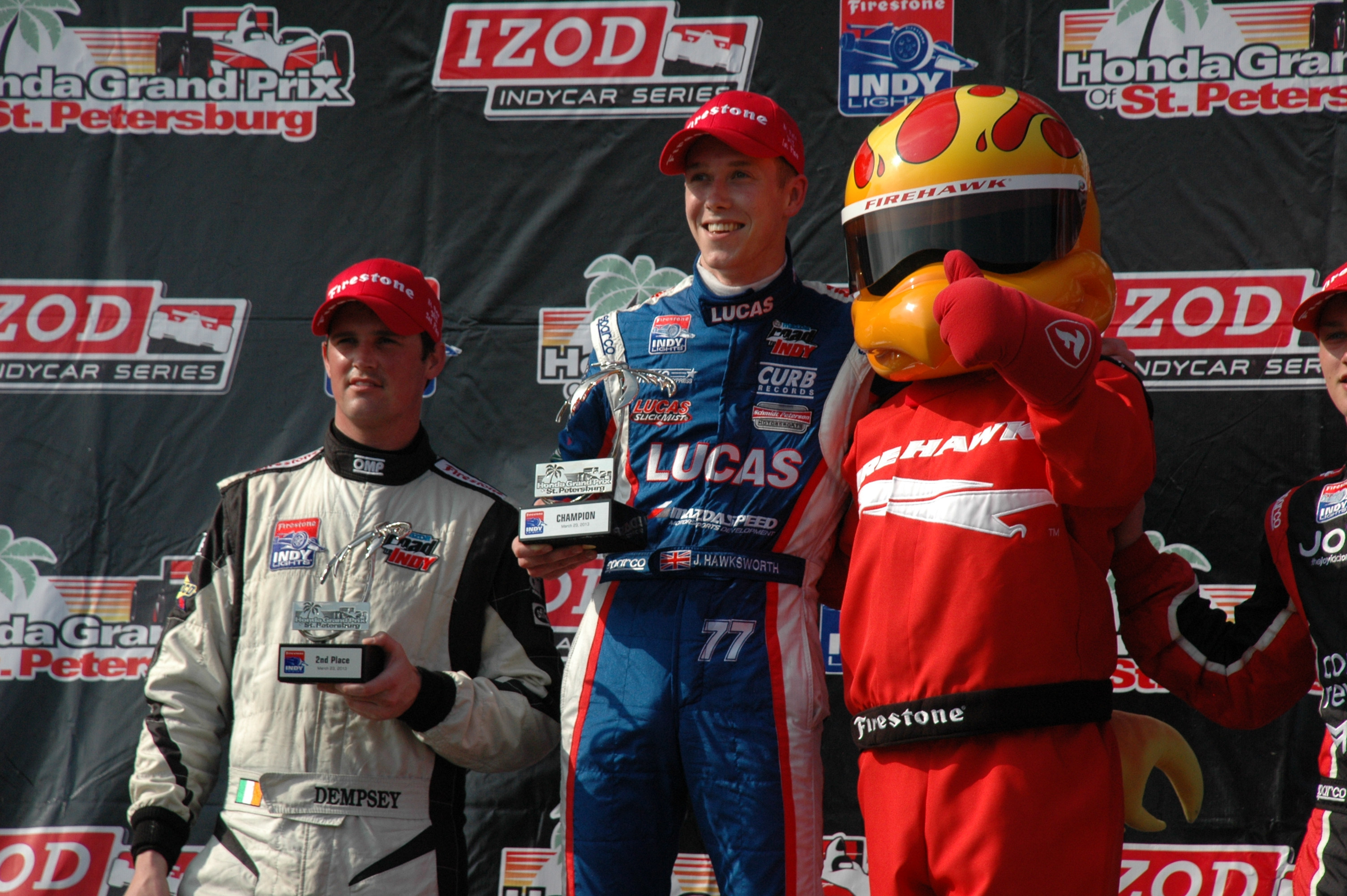 On the podium with Firehawk from Firestone, Dempsey (left) and Hawksworth. (photo: Rick Sassone / Rocket Sports & Entertainment Network)