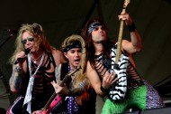 Steel Panther Band Ralph Saenz (aka Michael Star) drummer, bassist, Travis Haley (aka Lexxi Foxxx), and guitarist, Russ Parrish, (aka Satchel)  (Photo by Travis Failey / RSEN)