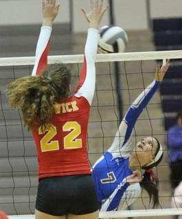 Jayna (22) goes up high for the block while playing for the Bishop Fenwick Falcons  (photo courtesy of Jayna Thompson)