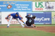 Jupiter Hammerheads second baseman Avery Romero slides into Dunedin Blue Jays short stop Emillo Guerrero's tag on Saturday night to end the second inning at Florida Auto Exchange Park.  Dunedin won the game that lasted 3:14, 12-7 (Eddie Michels/Photo)