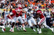 joel stave (2) pitches the pigskin to Melvin Gordon (Travis Failey / RSEN)