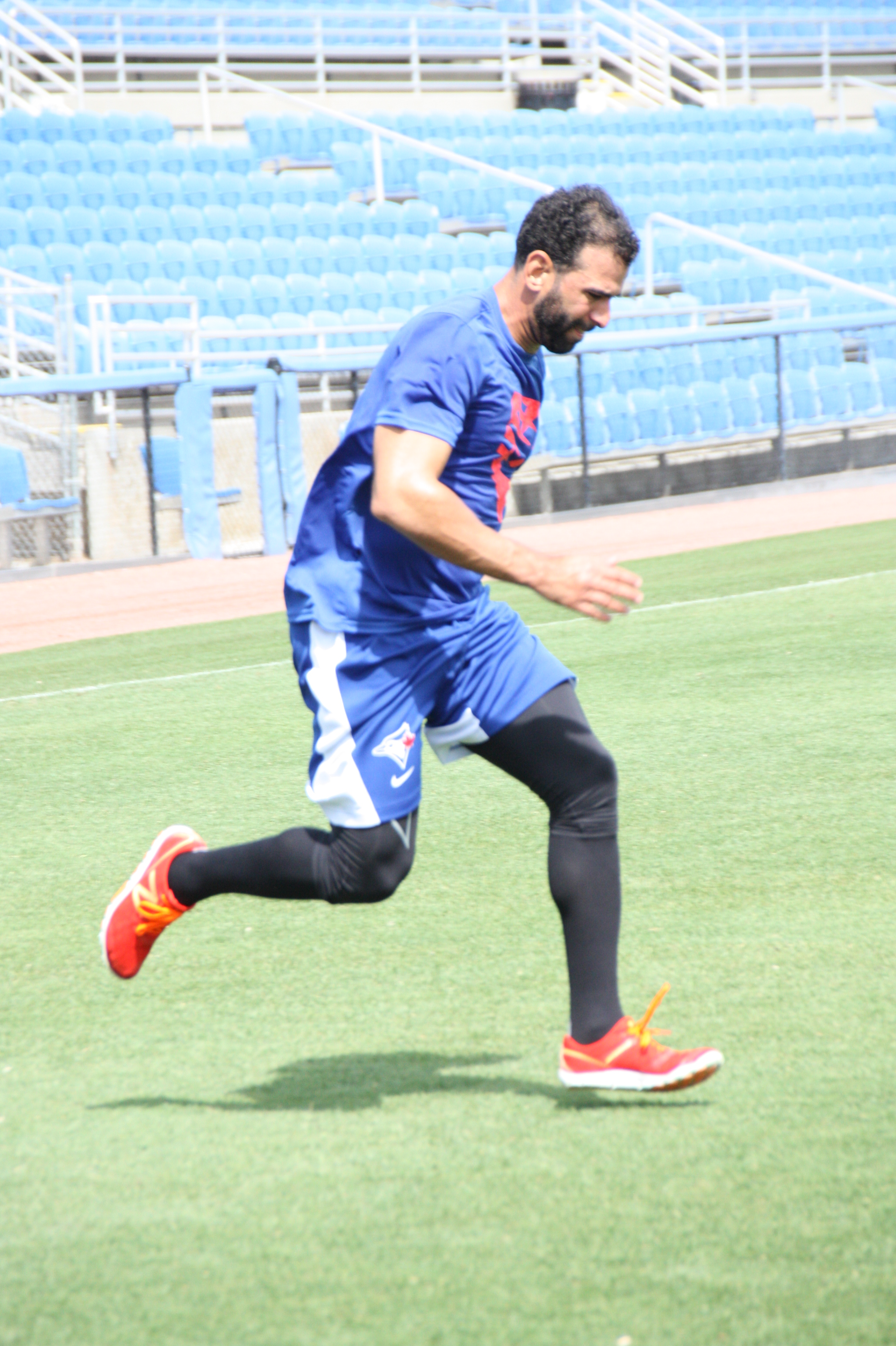 Toronto Blue Jays RF Jose Bautista (right leg) appears to have no problems running on the outfield turf at Florida Auto Exchange Stadium on Thursday. (EDDIE MICHELS/PHOTO)