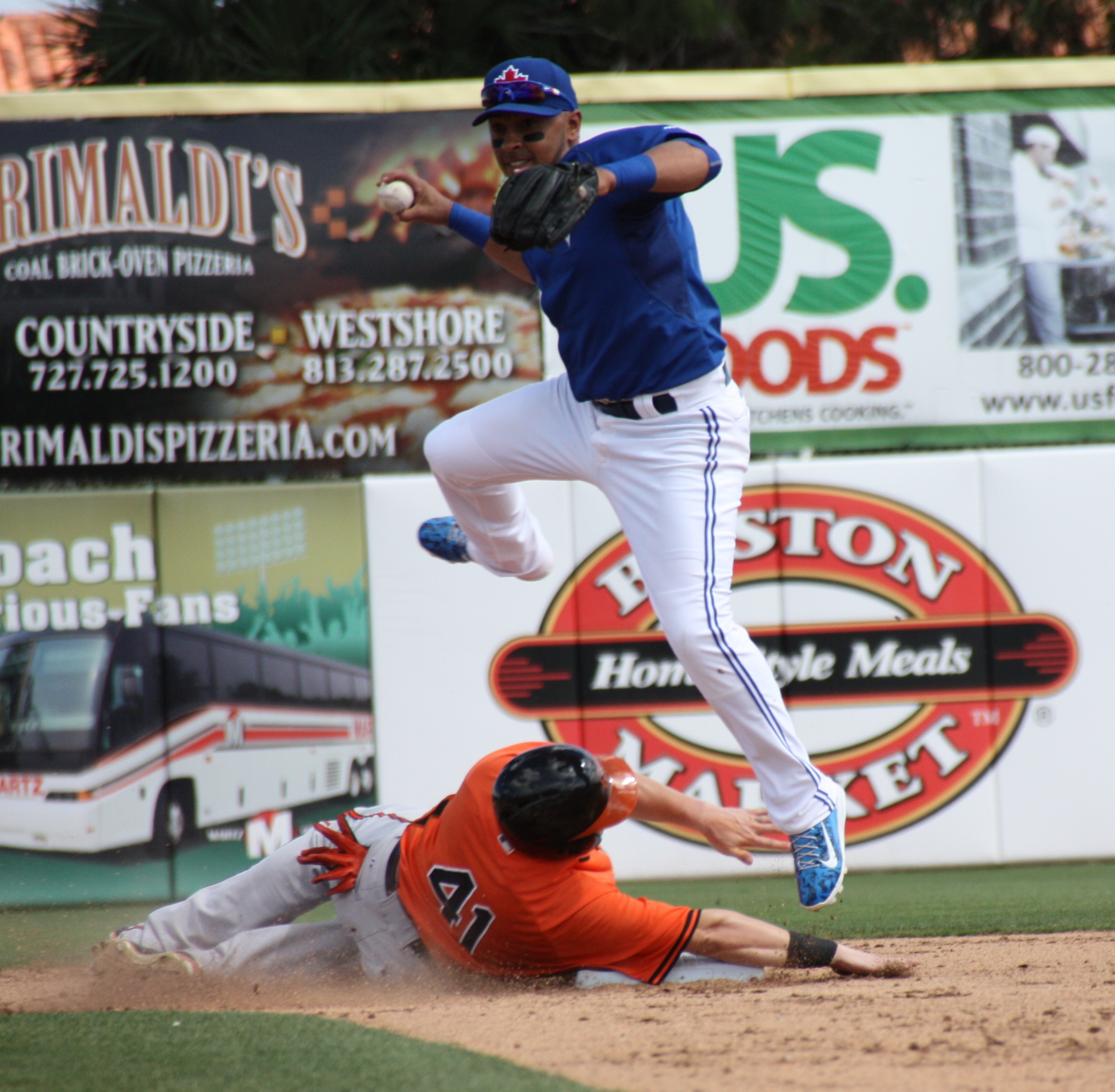 Maicer Izturis can't complete the double play in the top of the sixth inning but still gets the force out on Oriole Chris Parmelee at second as the Blue Jays prevail 5-3 (EDDIE MICHELS PHOTO)