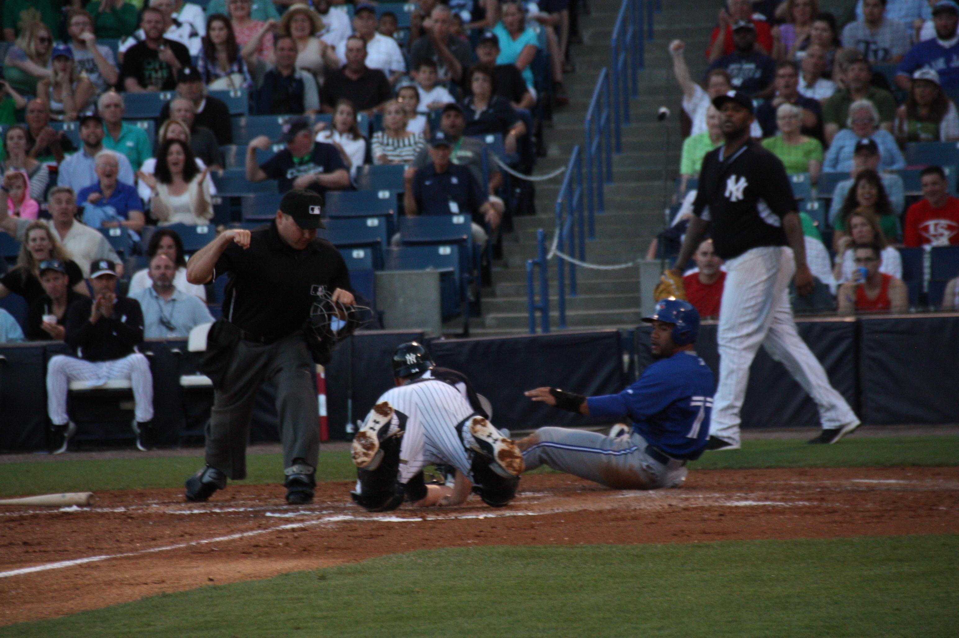 Blue Jays Devon Travis was gunned down at home by  Yankee shortstop Di Di Gregorius. (EDDIE MICHELS PHOTO)