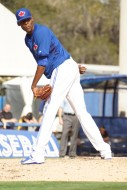 Blue Jays prospect Miguel Castro gave a death stare to the runner at first during his one inning of work against the Pirates on Tuesday.  At six feet seven inches the 20-year old is quite impressing on the mound. (EDDIE MICHELS/PHOTO)