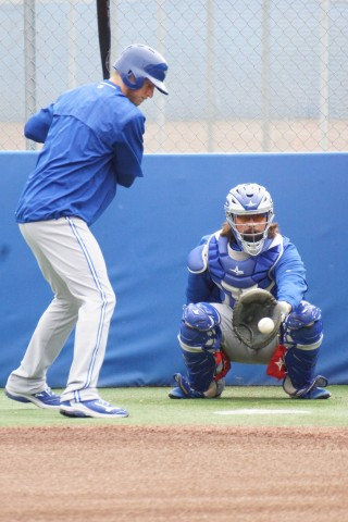 Blue Jays OF Michael Saunders (left knee) might not be able to start swinging a bat yet since his surgery but he can still keep his eye sharp.  Here Saunders watches delivery's from fellow Canadian Jeff Francis. (EDDIE MICHELS PHOTO)