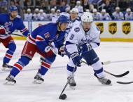 Dec 1, 2014; New York, NY, USA; Tampa Bay Lightning center Tyler Johnson (9) controls the puck in front of New York Rangers right wing Jesper Fast (19) during the first period at Madison Square Garden. (USA TODAY Sports -  Adam Hunger)