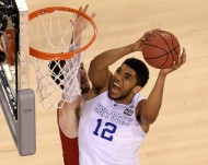 Apr 4, 2015; Indianapolis, IN, USA; Kentucky Wildcats forward Karl-Anthony Towns (12) shoots the ball against Wisconsin Badgers forward Frank Kaminsky (44) during the second halfof the 2015 NCAA Men's Division I Championship semi-final game at Lucas Oil Stadium. Mandatory Credit: Robert Deutsch-USA TODAY Sports