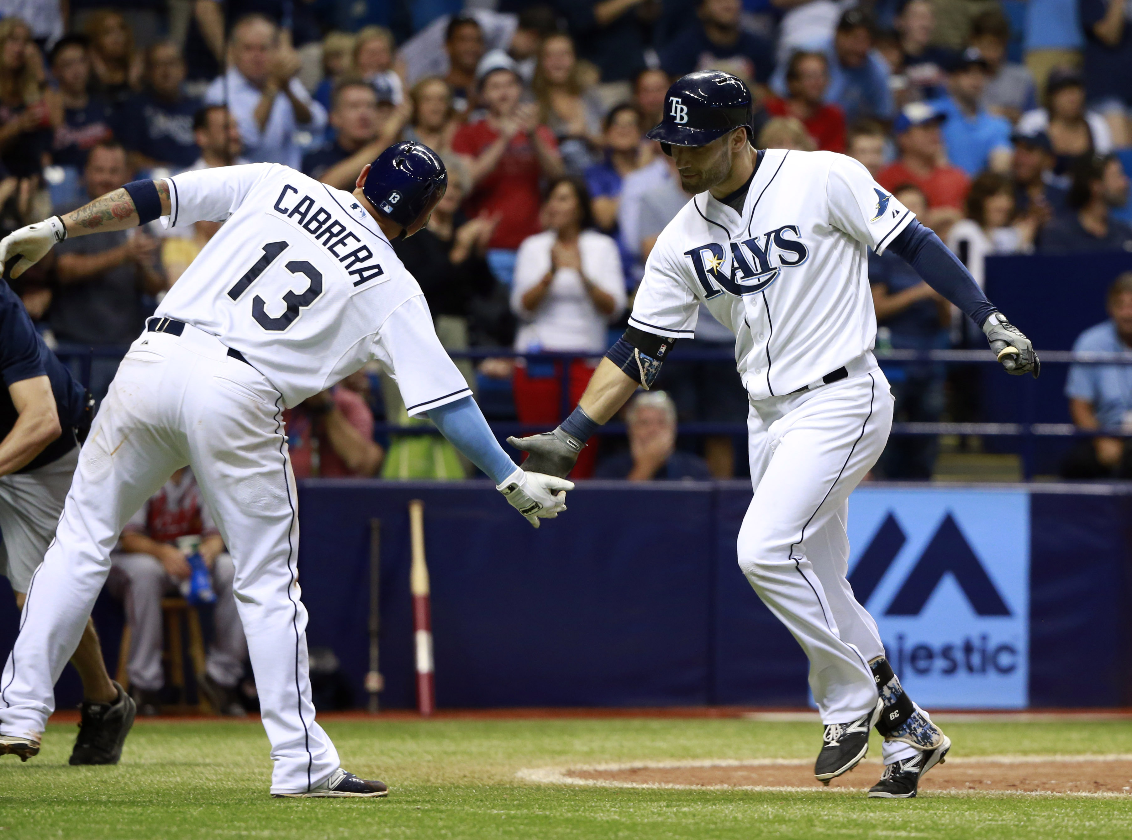 Tampa Bay Rays center fielder Kevin Kiermaier (39) is congratulated by shortstop Asdrubal Cabrera (13) after Kiermaier hit a 2-run home run during the seventh inning against the Atlanta Braves at Tropicana Field. (photo Kim Klement / USA TODAY Sports)