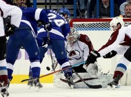Oct 29, 2015; Tampa, FL, USA; Tampa Bay Lightning right wing Ryan Callahan (24) shoots as Colorado Avalanche goalie Semyon Varlamov (1) makes a save during the first period at Amalie Arena. Mandatory Credit: Kim Klement-USA TODAY Sports