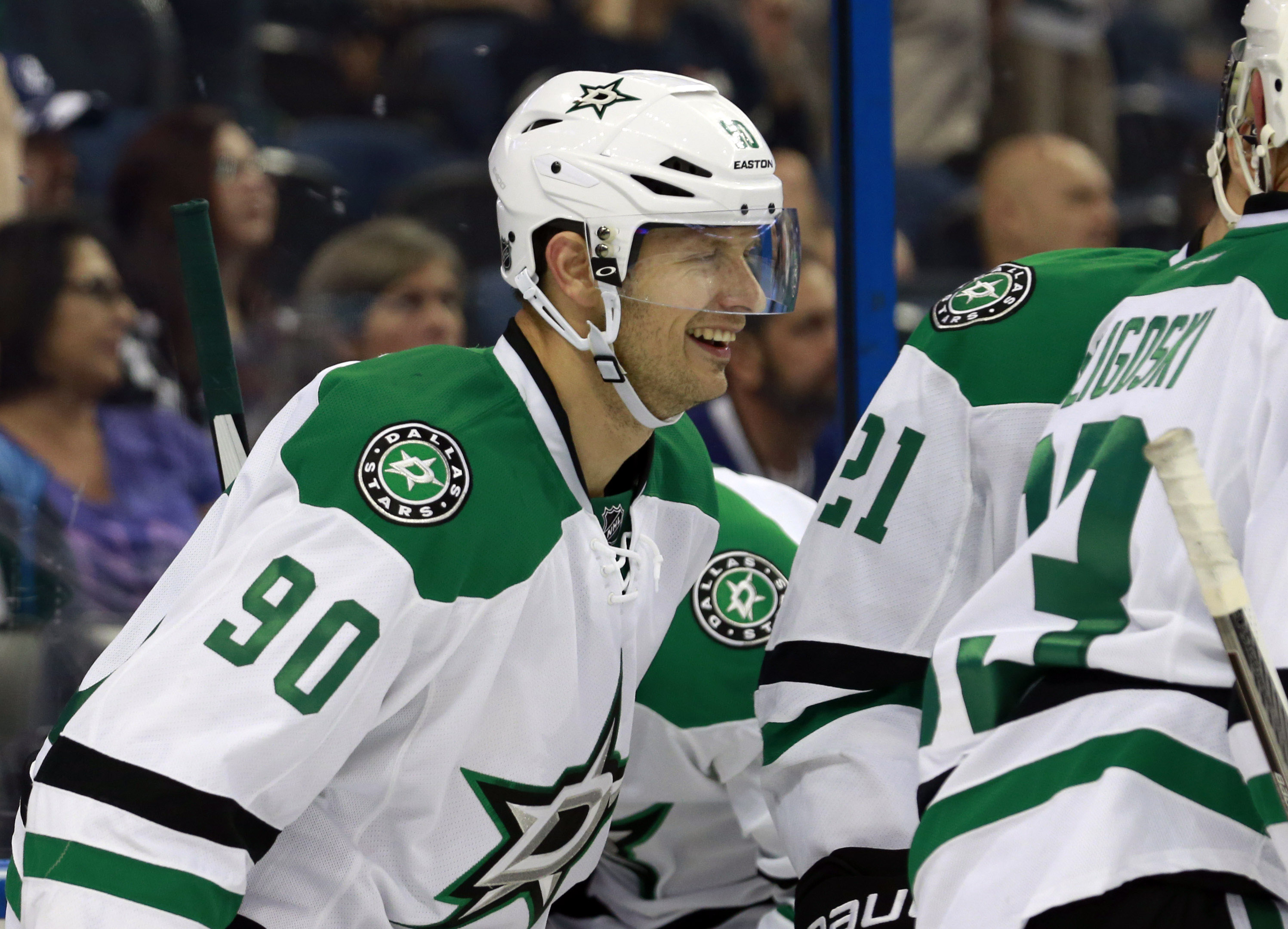 Jason Spezza (90) is congratulated by teammates as he scored the 5th Stars goal.  Sepia was named the number one star. (Kim Klement / USA TODAY Sports)