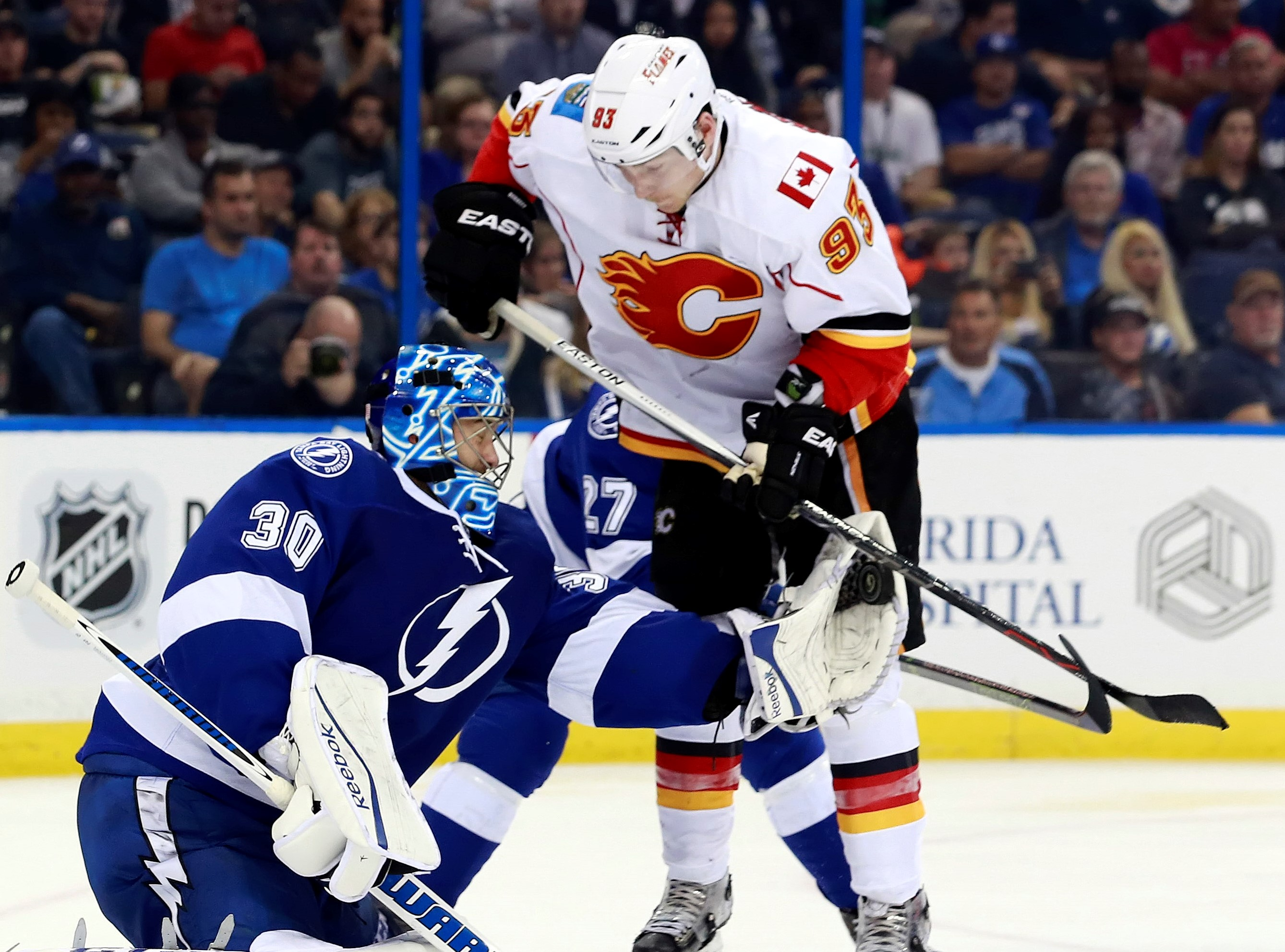 Nov 12, 2015; Tampa, FL, USA; Tampa Bay Lightning goalie Ben Bishop (30) makes a save from Calgary Flames center Sam Bennett (93) during the third period at Amalie Arena. Tampa Bay Lightning defeated the Calgary Flames 3-1. Mandatory Credit: Kim Klement-USA TODAY Sports