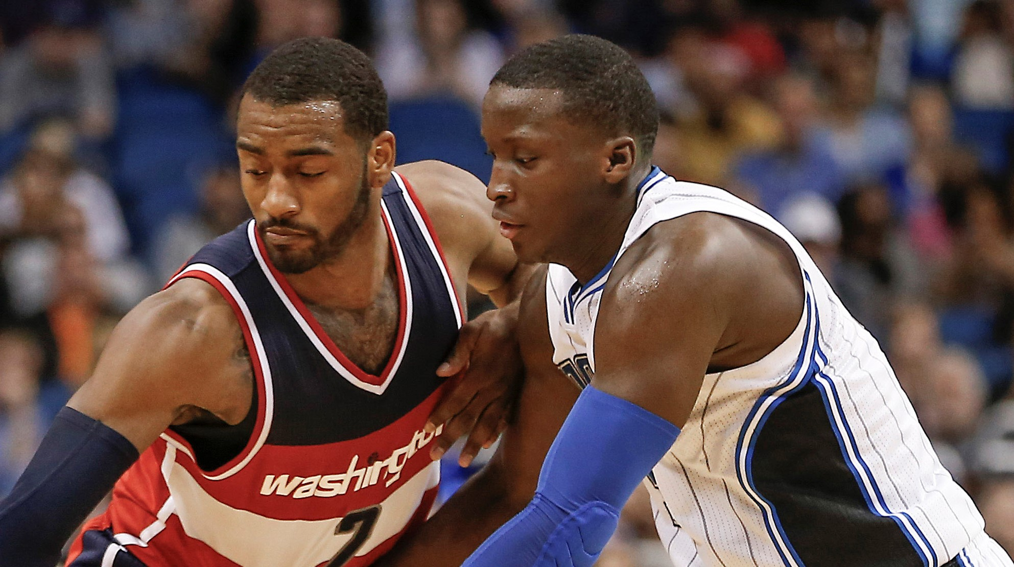 Jan 9, 2016; Orlando, FL, USA; Orlando Magic guard Victor Oladipo (5) and Washington Wizards guard John Wall (2) compete for a loose ball during the second half at Amway Center. The Washington Wizards won 105-99. Mandatory Credit: Reinhold Matay-USA TODAY Sports