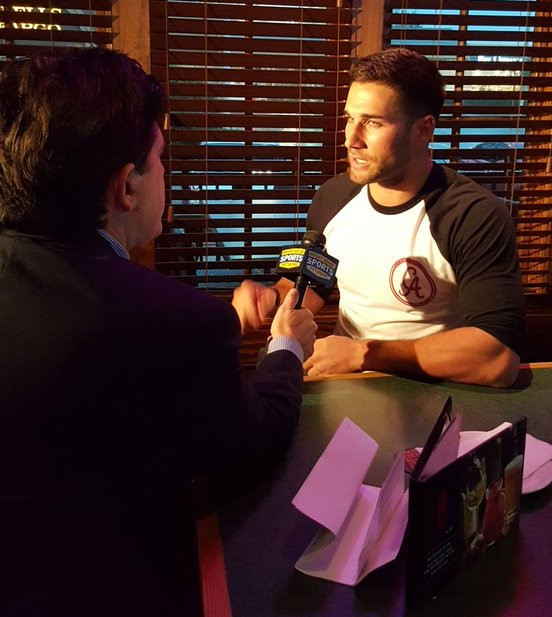 Rock Riley with Brighthouse Sports sits down with Rays centerfielder Kevin Kiermaier at Smokey Bones in Clearwater.  (RSEN photo)