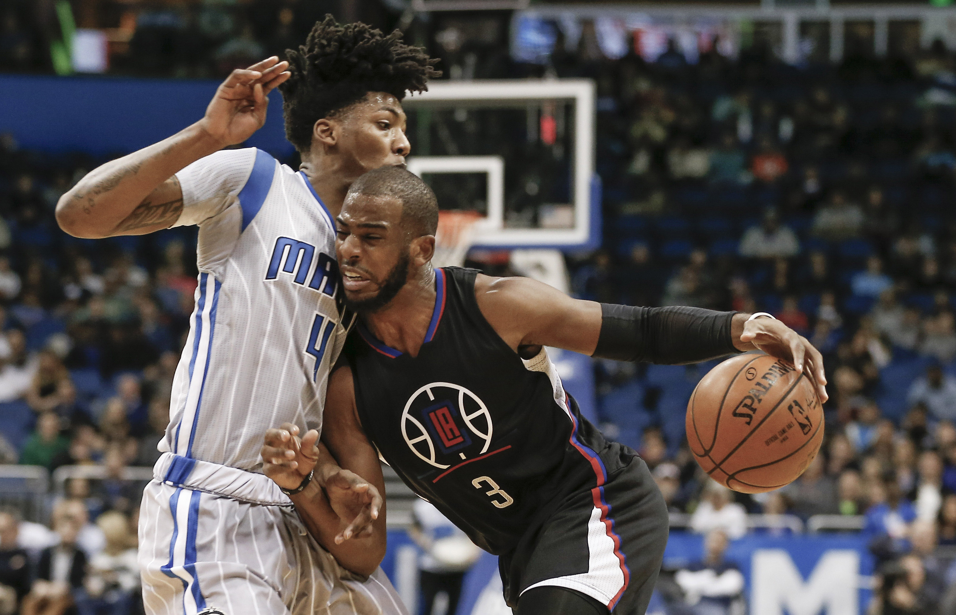 Elfrid Payton (4) defends against the drive from Los Angeles Clippers guard Chris Paul (3) during the first quarter. (photo Reinhold Matay / USA TODAY Sports)