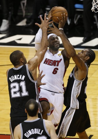 The cowardly Lion drives to the basket between Tim Duncan (21) and Kawhi Leonard (2) during the third quarter of game seven in the 2013 NBA Finals at American Airlines Arena.(photo by: USA TODAY Sports Derick Hingle)