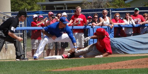Revere slides in third in a spring training game vs Toronto (EDDIE MICHELS/PHOTO)
