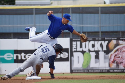 Dunedin Blue Jays second baseman Peter Mooney gets taken out during a double play attempt during the first inning on Monday June 23, 2014 against Brevard County.  Unfortunately Mooney didn't have the ball as he dropped the throw from third for an error and his acrobatics went for naught. (Eddie Michels/Photo)