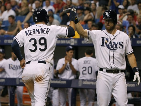 Kevin Kiermaier (39) is congratulated by second baseman Ben Zobrist during the seventh inning against the St. Louis Cardinals at Tropicana Field.  photo:  Kim Klement / USA TODAY Sports