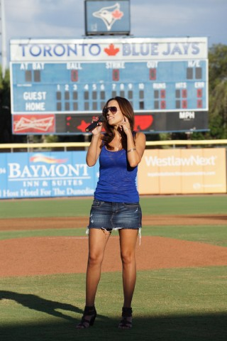 he Rookie Level Gulf Coast League is professional baseball without all the frills like announcements, mascots, contests with fans, give aways and much less the United States National Anthem preformed prior to the games first pitch.  On Tuesday July 8, 2014 prior to the Phillies-Blue Jays game at Florida Auto Exchange Stadium Manda Minch sang the Star Spangled Banner for about 100 fans and scouts assembled to watch the game.  Previously this season the Blue Jays played a recording of the National Anthem prior to their game on July 4th at their minor league complex. (Eddie Michels/Photo)