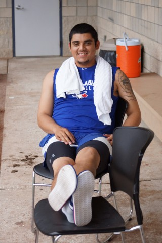 Blue Jays prospect Roberto Osuna takes a break after workouts on Wednesday July 16, 2014 with the Dunedin Blue Jays. (Eddie Michels/Photo)