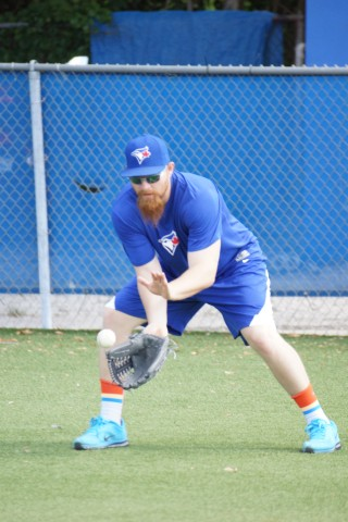 Wait! Will Adam Lind be trying out for the Miami Dolphins? Nice Socks! Nice Shoes! (Eddie Michels / Photo)