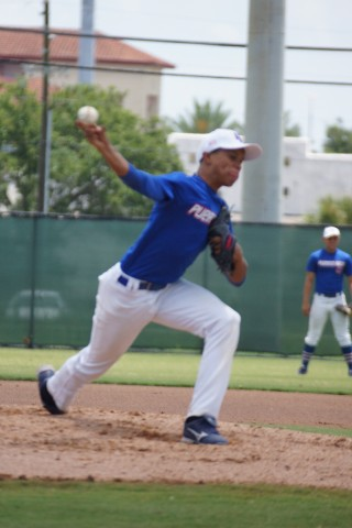 Right-hander Michael Cruz warms up for the Puerto Rico Under 16 squad at the Joe DiMaggio Complex during the International Baseball Congress Southern World Series.  Cruz was facing the South Florida Storm. (Eddie Michels/Photo)