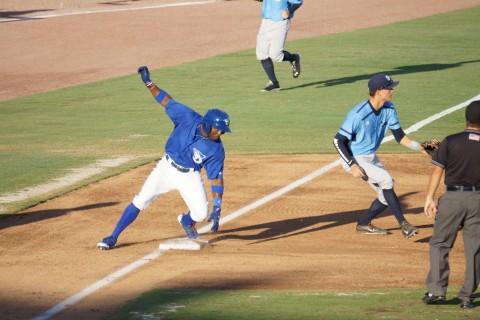 Dwight Smith Jr. gets in at third (Eddie Michels photo)