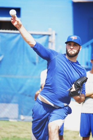 Blue Jays RHP Brandon Morrow (torn tendon right index finger) throws long toss on Monday July 28, 2014 during his first workout at the team's Mattick Complex. On the 60-day DL Morrow threw upwards of 100-110 feet on flat ground before throwing a 30-pitch bullpen session. (Eddie Michels/Photo)