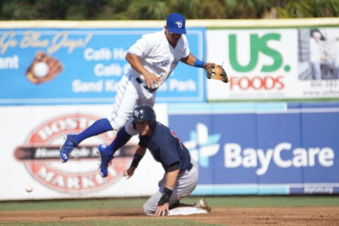 -Dunedin Blue Jays SS Peter Mooney takes the sliding hit from the Tampa Yankees Jake Cave but Cave is still out on Sunday July 6, 2014      Mooney hung onto the throw from 2B Christian Lopes but bobbled the exchange to complete the double play. (Eddie Michels/Photo)