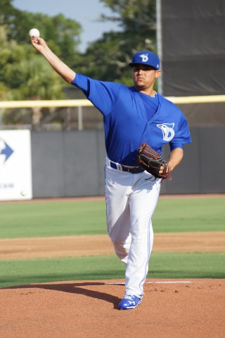 "DUNEDIN, Fl.--RHP prospect Roberto Osuna allowed three runs in his first start for Class-A Dunedin just a year and six days after ""Tommy John Surgery.""      Signed as a free agent in 2011 out of Sinaloa, Mx. Osuna used his fastball that topped out at 96 MPH to allow four hits, walk one and struck out five over  3 1/3 innings throwing 54-pitches.      ""No, no problems,"" said the 19-year old afterwards, ""I'll pitch next Wednesday (8-6-14) in Lakeland.""      As Osuna left the field for the clubhouse the Dunedin bullpen in mass greeted him saying, ""Welcome Back."" (Eddie Michels photo)"