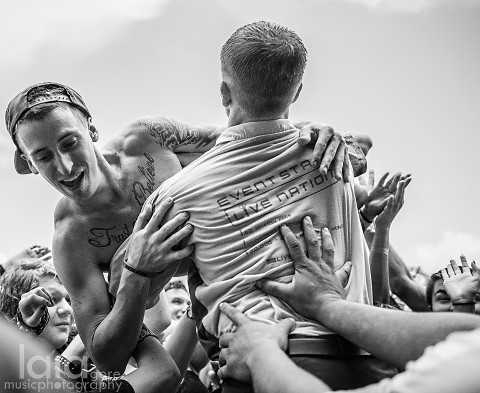 Crowd surfer during The Devil Wears Prada by Laia Gore