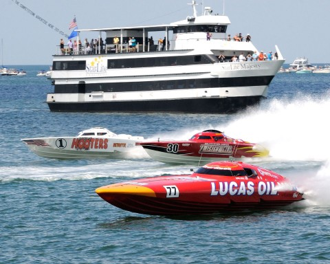 Superboat Extreme, the action was close throughout the field, the Lucas Oil leads the Twisted Metal and the Hooters boat past the fans on the Star Light Cruise Ship. (Chuck Green  / Cg Photography)
