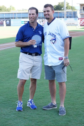 Toronto Blue Jays Florida Operations Director Shelby Nelson (L) presents RHP Taylor Cole with the team's 2014 Community Service award.  This was done prior to the Dunedin Blue Jays last home game of the regular season on August 27, 2014. (EDDIE MICHELS/PHOTO)