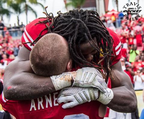 Appreciative of his teammates, Melvin Gordon has a big hug for senior TE Sam Arneson (Travis Failey / RSEN)