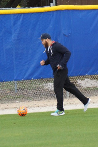 Russell Martin kicks around a soccer ball in the outfield (EDDIE MICHELS PHOTO)