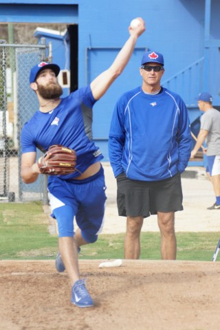 Daniel Norris takes a break on Monday February 16, 2015 between interviews to throw a bullpen session as bullpen coach Dane Johnson looks on.  Norris had interviews with NBC and ESPN on Monday. (EDDIE MICHELS PHOTO)