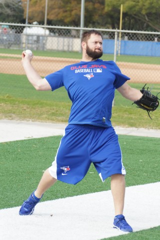 Todd Redmon gets loose throwing long toss.  Redmond is a St. Pete native and play his college ball at St. Pete Junior College. (EDDIE MICHELS/PHOTO)