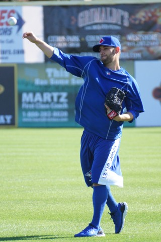 Marco Estrada throwing long toss.  Estrada was traded to the Blue Jays on December 1, 2014 for 1B/DH Adam Lind (EDDIE MICHELS PHOTO)