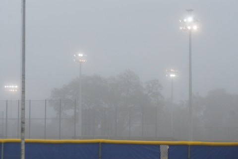 jAYS IN THE FOG...The lights were turned on at the Mattick   Complex until 9:30 AM on Monday as a heavy fog shrouded the area prior to the Blue Jays arriving for their first workouts for pitchers and catchers.  By the time the players finished their stretching exercises the fog had subsided. (EDDIE MICHELS/PHOTO)