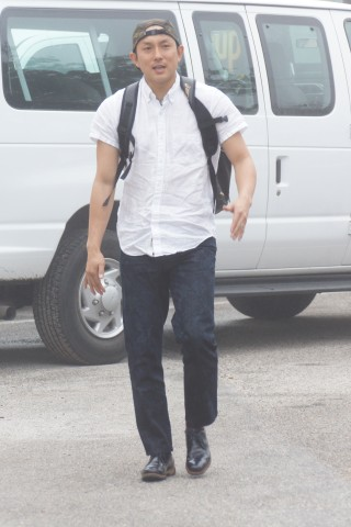 Munenori Kawasaki arrives for his first day of  work with backpack in tow. (EDDIE MICHELS PHOTO)