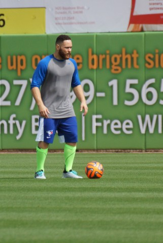 RUSSELL MARTIN is getting in his kicks in the outfield The lights were turned on at the Mattick Complex until 9:30 AM on Monday as a heavy fog shrouded the area prior to the Blue Jays arriving for their first workouts for pitchers and catchers.  By the time the players finished their stretching exercises the fog had subsided. (EDDIE MICHELS/PHOTO)