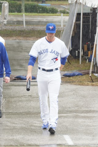 Less than 24-hours after surgery to repairs his torn left knee Toronto Blue Jays left fielder Michael Saunders was up, around and taking part in the teams photo day.  Here Saunders is shown walking towards the camera outside the teams spring training stadium. (EDDIE MICHELS/PHOTO)
