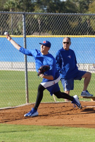 "First round pick (ninth overall) in 2014 Jeff Hoffman throws a 25-pitch bullpen session on Friday February 6, 2015 under the watchful eye of Blue Jays minor league pitching coordinator Darold Knowles.  Hoffman had ""Tommy John Surgery"" last May 14th and has been throwing bullpen sessions every Monday and Friday for the past four weeks. (EDDIE MICHELS/PHOTO)"
