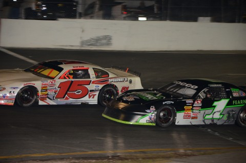 Bradley Babb (15) held off Keith Rocco.  Abb finished 4th and Rocco 6th.  (Rodney Meyering / RSEN photo)