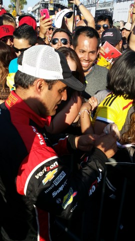 Juan Pablo Montoya celebrates with and signs autographs for the Colombian contingency (RSEN staff photo)