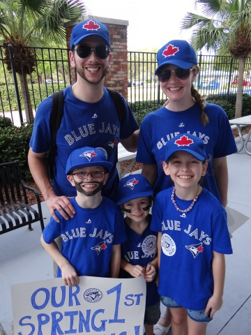 The Wood family of Thornton, (outside Barrie) Ontario made the trip south to Dunedin, Fl. for their first Toronto Blue Jays spring training game on Tuesday March 10, 2015.  Pictured in the front row are Oscar, Jasper and Bella while their proud parents Benn and Charlotte stand behind.  Working in the electronics industry in Canada,  Benn and his family are from Swindon, England. (EDDIE MICHELS/PHOTO)