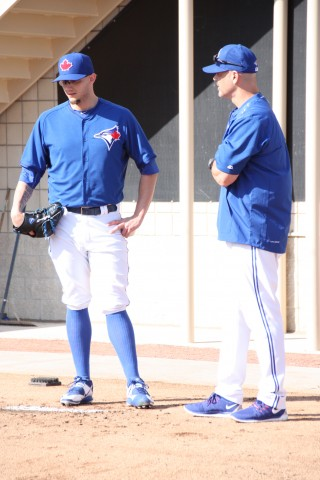 Pete Walker (right) keeps close watch of Brett Cecil's bullpen session. (EDDIE MICHELS PHOTO)